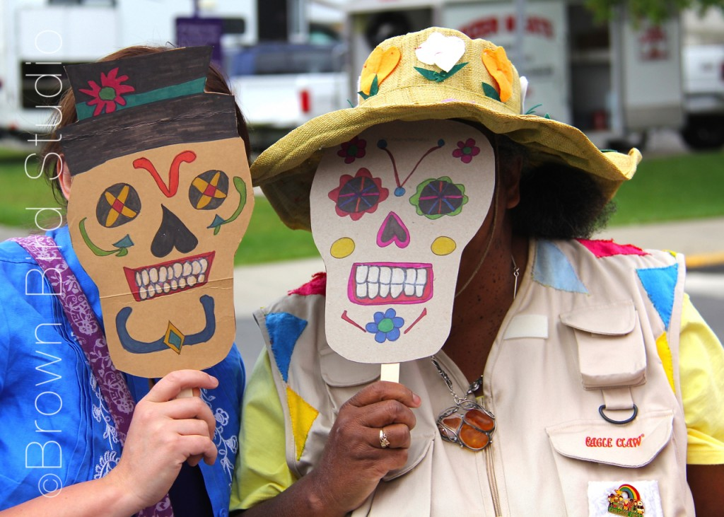 lady selling masks she made at the farmers market